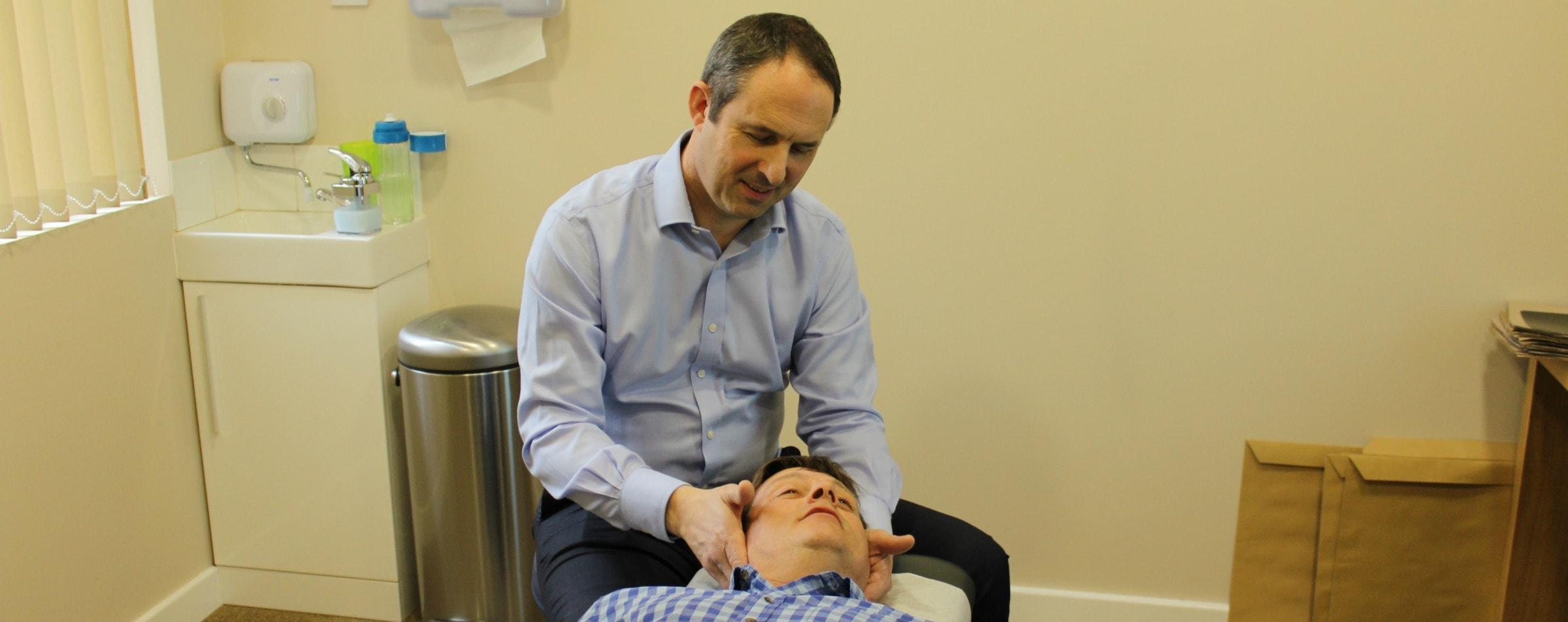 ben chiropractor in birmingham with patient