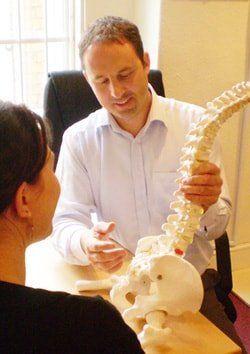 ben birmingham chiropractor with patient
