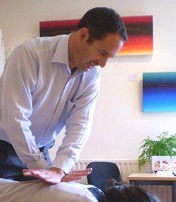ben chiropractor birmingham image with patient